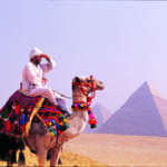 Camel Rider and the Great Pyramids in Egypt