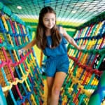 Girl climbing in play area